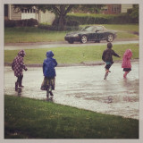 Kids rain puddle stomp_hip